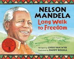 Front Cover of the children's book version of Nelson Mandela's Long Walk to Freedom.  Madiba on the left side facing to the right and smiling, behind him is a vista of South Africa.
