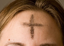 Cross of ashes on forehead