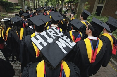 "graduate with ""Hire Me"" on top of mortarboard"