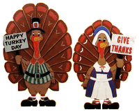 "Turkey cartoon characters with signs saying ""Happy Turkey Day"" and ""Give Thanks"""