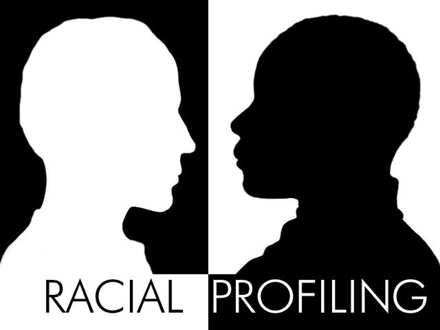 A graphic image in profile.  Two figures.  One a white head on balck backg round, the other a black profile of a person's head on a white background.  Underneath is the text: Racial Profiling.