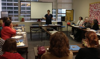 Carol Smolenski speaking to seminar group