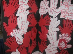 A display of Red Hands with the message that children are children, not soldiers