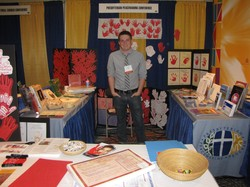 The Peacemaking Program booth with Red Hand Campaign materials