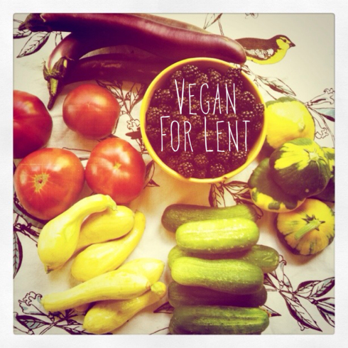 Vegan for Lent visual that has a collection of vegetables arrayed around a bowl of blackberries.