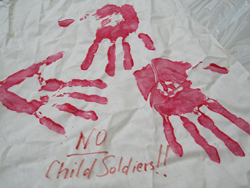 "Red hand imprints, text"" No Child Soldiers!!"