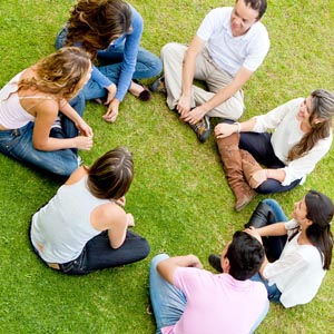 People in a circle on the grass