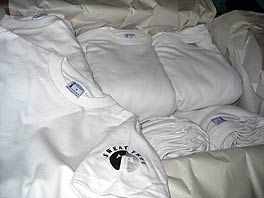 photo of T-shirts in a packing box