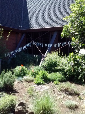 prayer flags hanging outside FPC Palo Alto