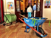 wheelbarrow of compost in the church