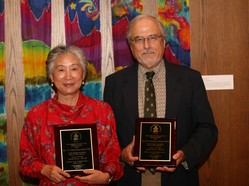 the Rev. Carol Chou Adams and the Rev. Dr. Daniel Adams receive awards for their 36 years of service