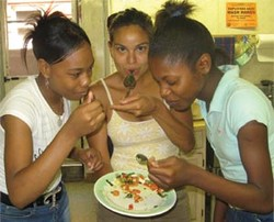Girls eating vegetables