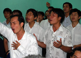 Photo of young men at worship
