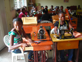 A group of women in a sewing class.
