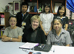 Sharon meeting with the principal and English teachers at Suebnathitham School.
