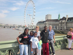 The Dimmock family at the Thames River in London, with The London Eye in the background.