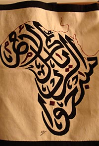 Photo of the outline of Africa made with Arabic writing