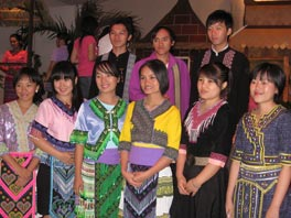 Photo of young women and men wearing colorful costumes.