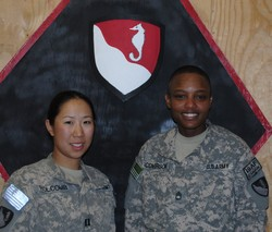 Photo of a young woman and young men dressed in Army camoflage uniforms.