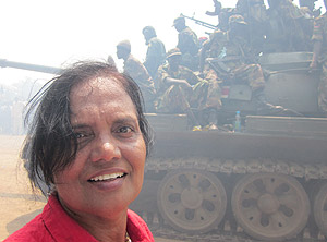 Aliamma, in front of a live Army Tank which came for protecting the people, there were 10 of them.