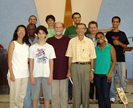 A group of people standing to have their photo taken; Thelma, Joel and Farris are standing to the right of the group.