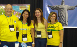 A man and three women wearing bright yellow shirts
