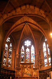 Interior of St. Philip and St. James Church. Arches and stained glass windows are featured.