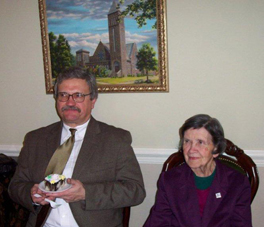 Photo of Larry Hinderliter sitting next to a woman.