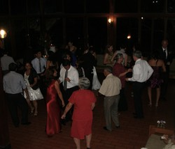 Photo of people in a circle on a dance floor.