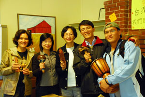 A group of people holding traditional Taiwanese instruments.