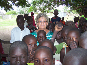A woman standing with a group of children.