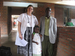 Barbara Nagy, standing beside a man and a little girl.
