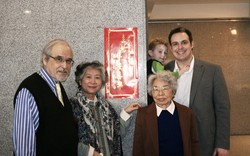 Jonathan, holdin Samuel, stands next to David and Carol Adams and Prof. Lin.