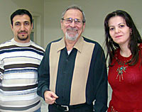 Photo of Nuhad Tomeh with a young man and a young woman. The three have stopped to pose to have their picture taken together.