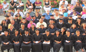 A large group of graduates together for a photo.