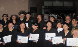 A group of graduates holding their diplomas.