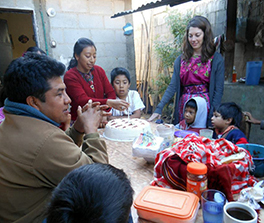 Rachel Lee, a YAV in Guatemala from 2012 to 2013, celebrates her birthday with her Guatemalan host family. Photo by Marcia Towers