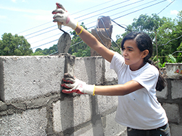 Sulmi Avigail Pineda Miranda, a ninth-grade student, helps others in Copan housing project, Trinidad. Photo by Tim Wheeler