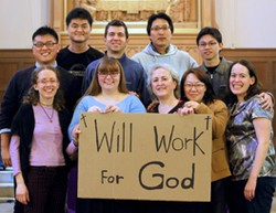 People holding will work for God sign