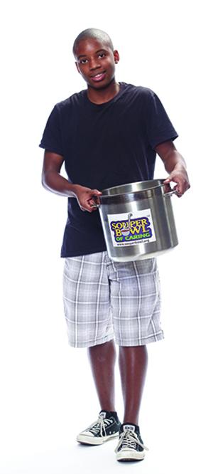 A boy with a pot of soup.