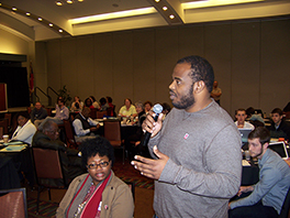 Seminary student Gerald Parks speaking at an AIDS forum