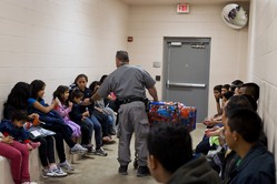 Central Americans awaiting processing in McAllen Texas after crossing the border into the U.S.