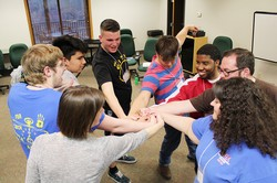 Rogers (one smiling – center of photo) enjoying a team building moment with other worship/production members at a planning meeting in March, for the 2016 Presbyterian Youth Triennium.