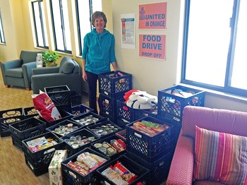 Janie Cearley Robinson, member of Wellshire Presbyterian Church in Denver, stands with some of the good collected for the Souper Bowl of Caring.