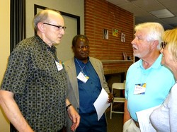 Rob Weingartner, executive director of the Outreach Foundation (left) speaks with Davidson Chifungo, Nkoma Synod, CCAP, following his missional focus group.