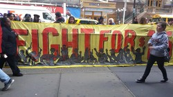 Fast-food workers protest in both Los Angeles and New York City to raise wages to $15 an hour.