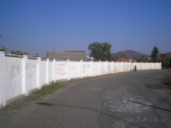 "A wall, recently constructed around a Roma ""camp,"" is meant to keep passing motorists from getting distracted, officials say."