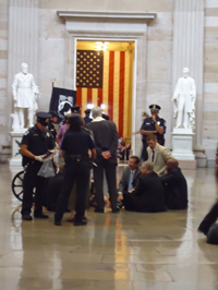 A group of religious leaders being arrested in the Capitol Hill Rotunda.