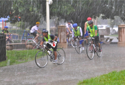 Cyclists riding in the rain.