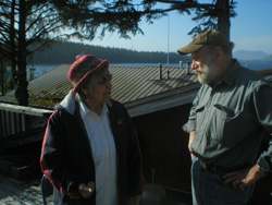 Two members of First Presbyterian Church of Craig and Klawock, talking together on a deck.